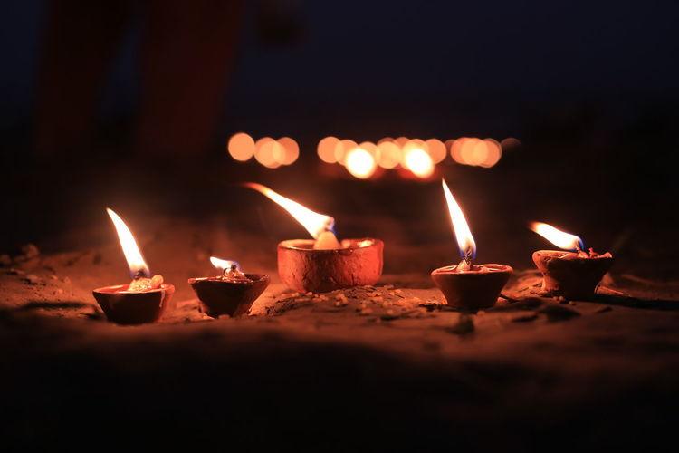 Diyas burning on land at night