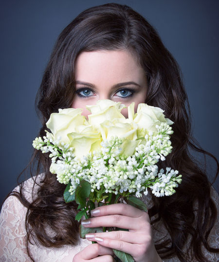 Beauty Bouquet Casual Clothing Close-up Flower Focus On Foreground Fragility Freshness Front View Headshot Holding Leisure Activity Lifestyles Petal Portrait Studio Shot Young Women