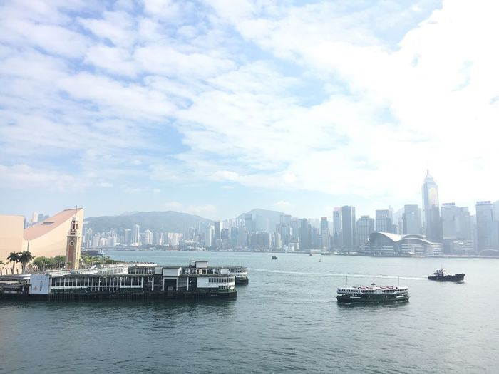 Victoria Harbour VictoriaHarbor Starferry HongKong Ferry Architecture Building Exterior City Skyscraper Built Structure Cityscape Transportation Waterfront Urban Skyline Sky Mode Of Transport Modern Nautical Vessel Tower Day No People Water Travel Destinations River Cloud - Sky EyeEmNewHere Fashion Stories EyeEmNewHere