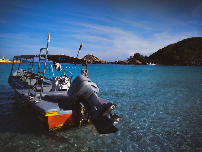The boat Water Nautical Vessel Scuba Diving Sea UnderSea Beach Blue Sky Motorboat Boat Island Water Vehicle Archipelago Recreational Boat 10