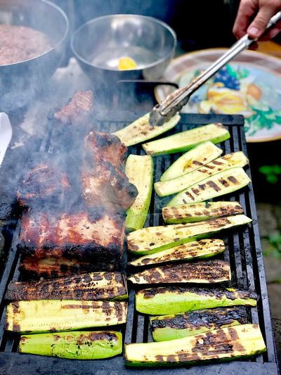 Barbecue Ribs Zucchini Barbecue Ready To Eat Food Food And Drink Hand Human Hand Freshness One Person Human Body Part Kitchen Utensil Preparation  Close-up Indoors  Wellbeing Healthy Eating Indulgence Multi Colored Unrecognizable Person Choice Holding High Angle View