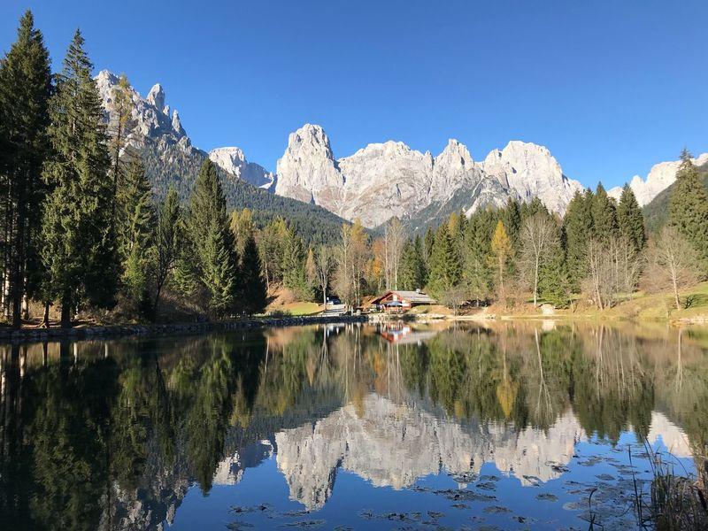 -Welsperg Lake in Val Canali- Reflection Mountain Nature Tranquil Scene Waterfront Clear Sky Water Scenics Lake Idyllic Beauty In Nature Tranquility Day Mountain Range Standing Water Sky Blue Tree Outdoors No People Freedom