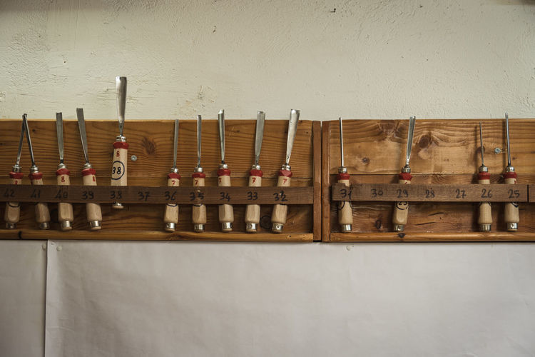 Chisels rack hanging against wall
