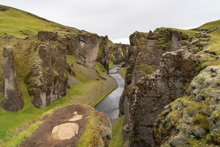 Fjaðrárgljúfur Iceland Beautifuliceland Beauty In Nature Day Environment Flowing Flowing Water Formation Landscape Mountain Nature No People Non-urban Scene Outdoors Plant Rock Rock - Object Rock Formation Scenics - Nature Sky Solid Tranquil Scene Tranquility Water