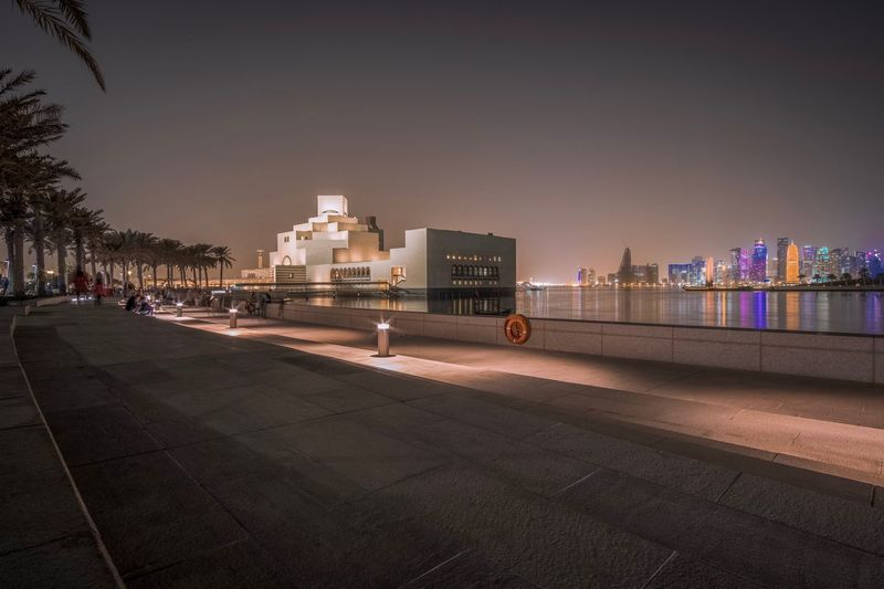 Museum of Islamic Art International Doha Qatar Middle East Architecture Outdoors Night Travel Destinations City Office Building Exterior Transportation Building Exterior Built Structure Urban Skyline No People City Street Cityscape Street Nature City Life Sky Building Illuminated Road