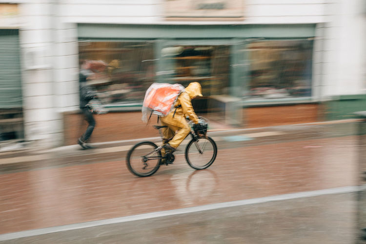 Rain Raining Rainy Days Rainy Season Rainy City City Bogotá Colombia South America Latin America Motion Blurred Motion Transportation Bicycle Building Exterior Built Structure Speed Architecture Sport Ride Activity Riding Lifestyles Real People People Men Day Full Length on the move