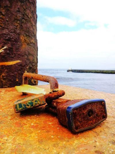 Padlocks Rust Walks Orange Color Beach Rusty Sea No People Day Nature Outdoors Sky Water Close-up