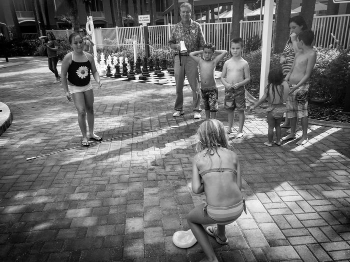 Kids Playing Games Water Balloon Toss About To Burst Perfect Timing Summer Fun Street Photography Action Shot  Black And White EyeEm Gallery EyeEm Best Shots - Black + White