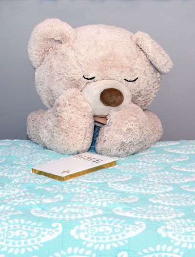 a large stuffed teddy bear says good night prayers while he kneels beside the bed with his bible Ritual Teddy Bears Art And Craft Bed Bed Time Prayers Bible Book Childhood Close-up Creativity Furniture Good Boy Indoors  Prayer Praying Publication Religion And Beliefs Representation Softness Still Life Stuffed Toy Table Teddy Bear Textile Toy