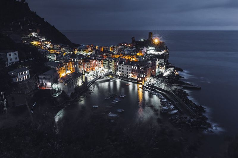 High angle view of buildings by sea in vernazza at night
