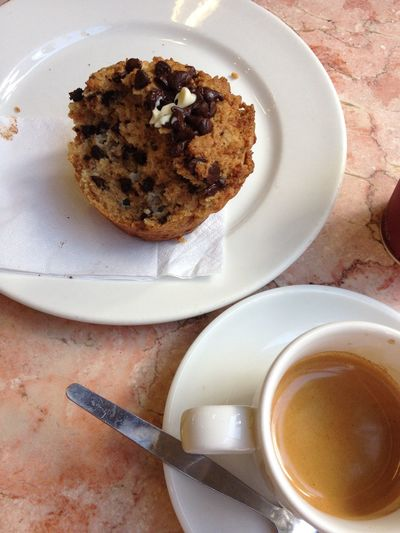 Close-up of cup cake and coffee cup on table
