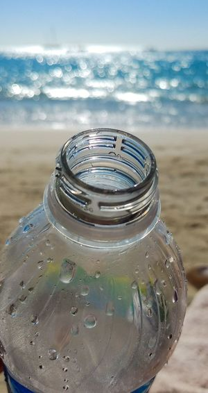 Plastic Bottle End Plastic Pollution Thirst Thirstymoment Thirstytraveler Drinking Drinking Water Beach Life Beachday Relaxing Time Peace And Quiet Water Bottle  Water Bottles 😍😍 Water Sea Beach Lid Close-up Cold Drink