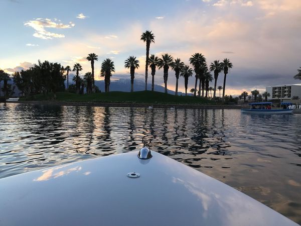 Palm Desert, CA Boat Boat Ride Dusk Colours Waterfront Calmness Sunset Palm Tree Silhouette Palm Trees Water And Sky Water And Sky Collection Been There.