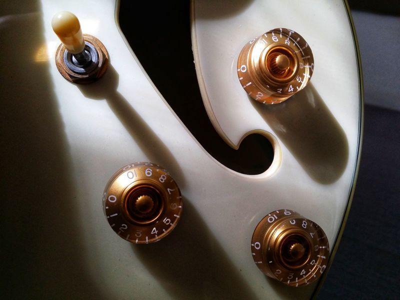 Switch and Knobs Indoors  High Angle View No People Music Close-up Gold Colored Musical Instrument Day Guitars Sound Hole Switch Knobs And Dials Vintage Vintage Style White Old Closeup Close Up Art Electric Guitar Jazz Music Eyeem Philippines Guitar Arts Culture And Entertainment