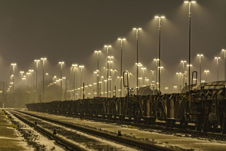Transportation Architecture Artificial Light Illuminated Lanterns Mode Of Transport Night No People Outdoors Rail Transportation Railroad Track Sky Snow Train Train - Vehicle Transportation Wagons Wintertime