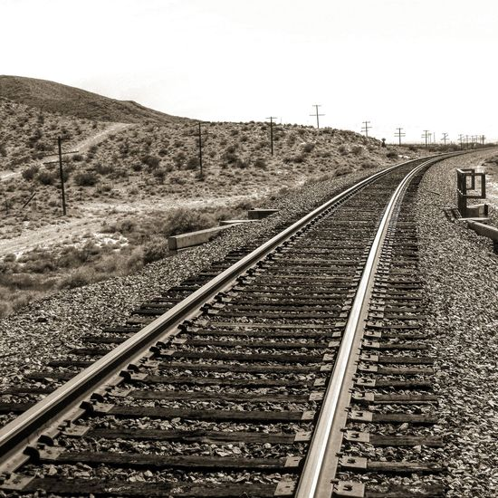Railroad Track Rail Transportation Transportation Outdoors Day No People The Way Forward Sky Landscape Nature Desert Sun Travel Travel Destinations Desert Landscape Las Vegas Nature Beauty In Nature Tranquility EyeEmNewHere Where Does It Lead? Mountain Range Mountain EyeEm Nature Lover