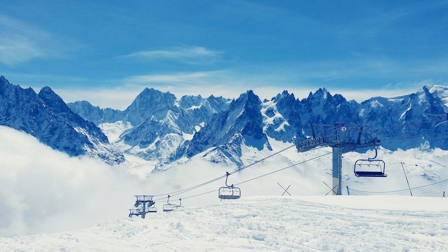 Ski Lifts On Snowcapped Mont Blanc Against Sky