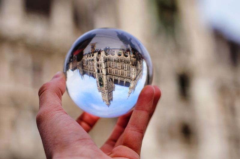 Sphere Reflection Holding Crystal Ball One Person People Adults Only Human Hand Outdoors Planet Earth Human Body Part Adult Human Eye Fragility Close-up Day Munich München Munich, Germany Sky Marienplatz Long Goodbye EyeEmNewHere