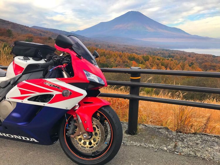 Mountain Transportation Mountain Range Mode Of Transport Motorcycle Land Vehicle Day Road Sports Race Outdoors Sports Track No People Helmet Auto Racing Motorsport Sky Tire Nature Racecar
