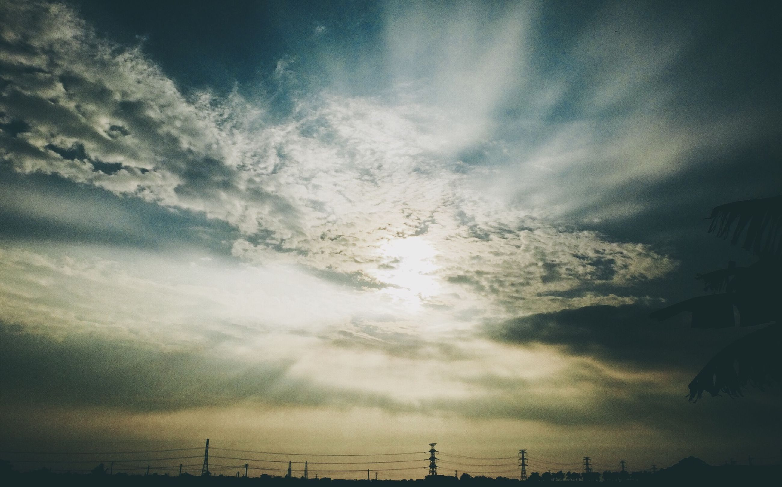 sky, cloud - sky, low angle view, cloudy, silhouette, weather, overcast, tranquility, nature, electricity pylon, beauty in nature, cloud, power line, fuel and power generation, electricity, dusk, scenics, tranquil scene, storm cloud, outdoors