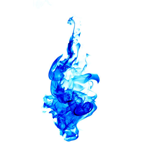 Close-up of blue water splashing against white background