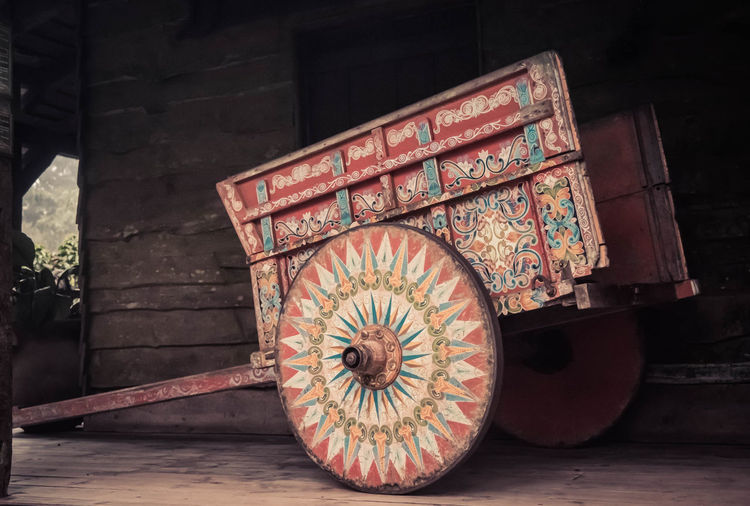 Traditional and Colorful Costa Rica Ox Cart Wood - Material No People Wheel Day Indoors  Old Transportation Table Creativity Circle Pattern Art And Craft Antique Shape Floral Pattern Cart Costa Rica Costa Rica 🇨🇷 Ox Cart Multi Colored Geometric Shape