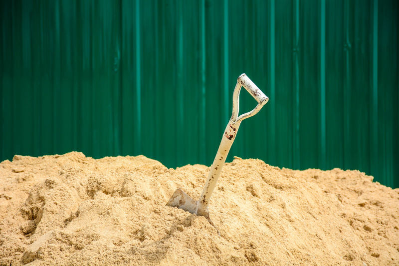 Close-up of shovel in sand