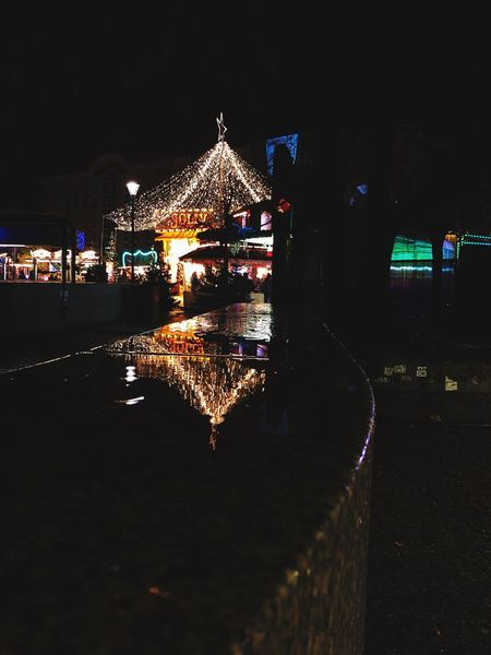 Reflecting Lights Reflection Illuminated Night Built Structure Architecture Building Exterior Outdoors Water Christmas Decoration No People Carousel Sky City