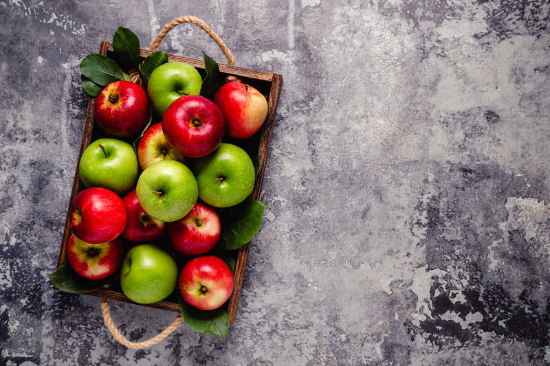 High angle view of apples in container on table