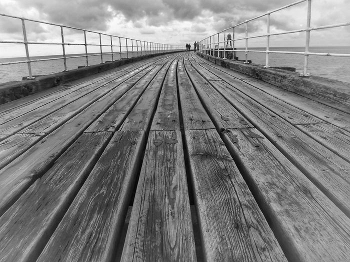Whitby pier Cloud - Sky Travel Destinations Bridge - Man Made Structure No People Parallel Pier Photos Whitbypier North Yorkshire Coast Whitby Beach Sea Monochrome Photography Built Structure Back & White Architecturephotography Whitby View Waves, Ocean, Nature Whitby North Yorkshire Malephotographerofthemonth Creative Light And Shadow Color Photography The World Through My Eyes Creative Light And Shadow Whitby Pier Close-up Yorkshire Coast Postcode Postcards Perspectives On Nature