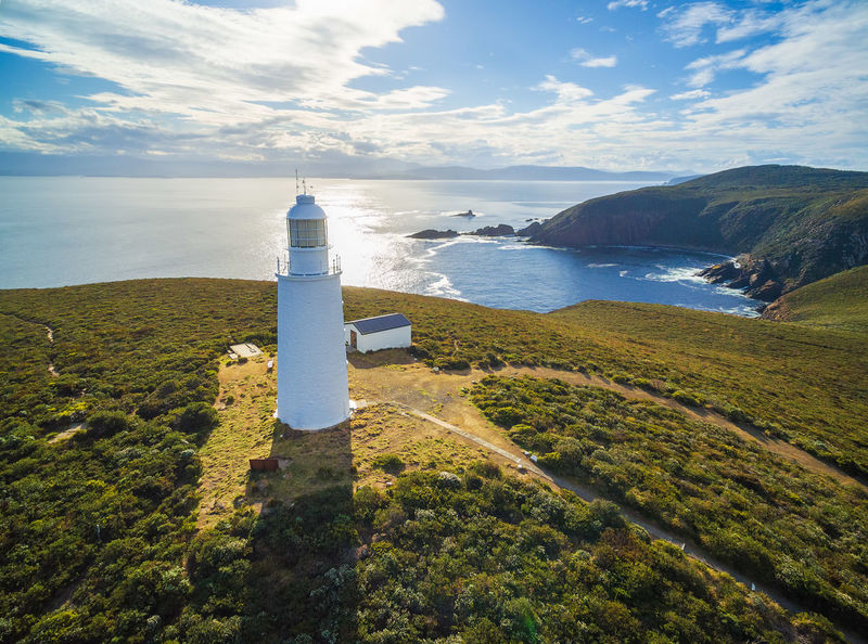 Aerial view of Bruny Island Lighthouse at sunset. Tasmania, Australia Aerial Aerial Photography Australia Beauty In Nature Bruny Island Cloud - Sky Cloudscapes Day Horizon Over Water Island Light Lighthouse Nature No People Outdoors Scenics Sea Sky Tasmania Tranquil Scene Tranquility Water