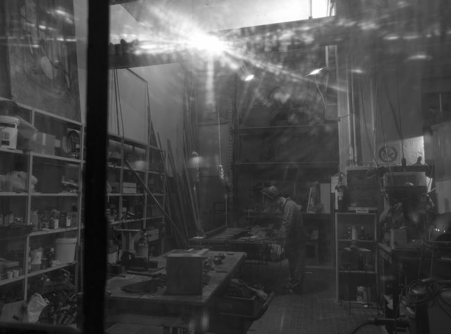Work Behind The Window EyeEm #NightLife #iron #steel Structure Industry Working Blackandwhite Garage Nightlife Focus On The Story