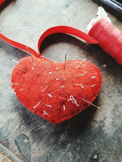 Close-Up Of Heart Shaped Pin Cushion On Table