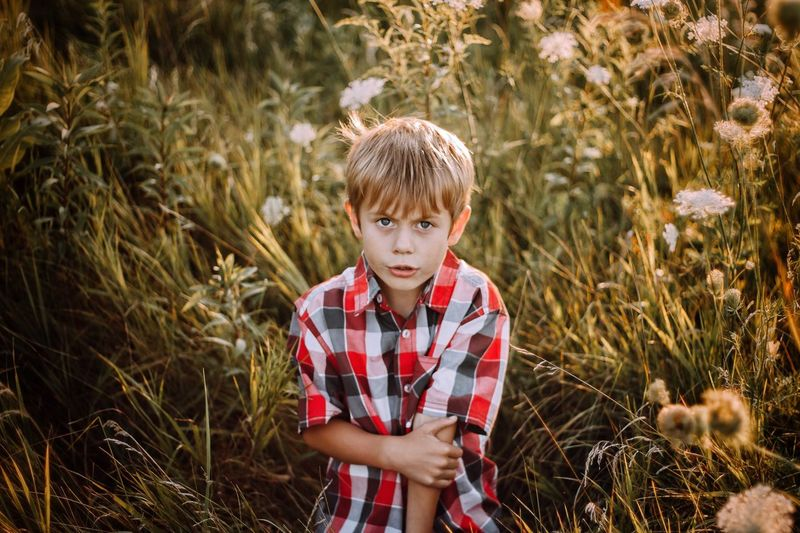 Kindergarten One Boy Only Children Only Childhood Boys Child Waist Up One Person Males  Blond Hair People Standing Grass Day Outdoors Rural Scene Portrait Nature Adult