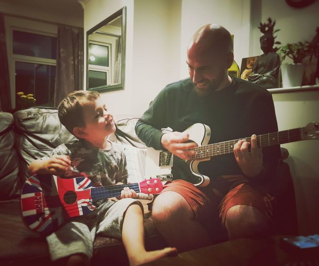 music lovers father & son Fatherhood Mome The Week on EyeEm Father & Son Childhood Child Children Chilling Music Togetherness Youandme MeAndDad Daddy Toddler  Plucking An Instrument Musician Electric Guitar Guitar Musical Instrument Bonding Togetherness Sitting Living Room Friendship The Photojournalist - 2018 EyeEm Awards EyeEmNewHere