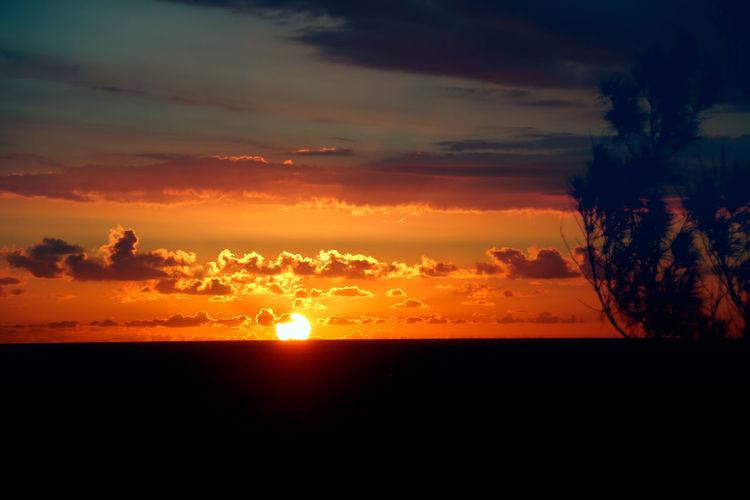 Bkue Sky Etang Salee Orange Sky Beauty In Nature Etang Salé Horizon Idyllic Landscape Le Gouffre Nature No People Orange Color Outdoors Scenics Silhouette Sky Sun Sunset Tranquil Scene Tranquility