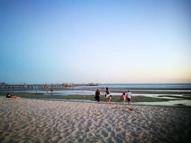 EyeEm Selects Beach Sand Sea Summer Horizon Over Water Sky Sunny Nature Clear Sky Vacations Water Outdoors Sunset Sun Blue People Sunlight Adult Full Length Togetherness