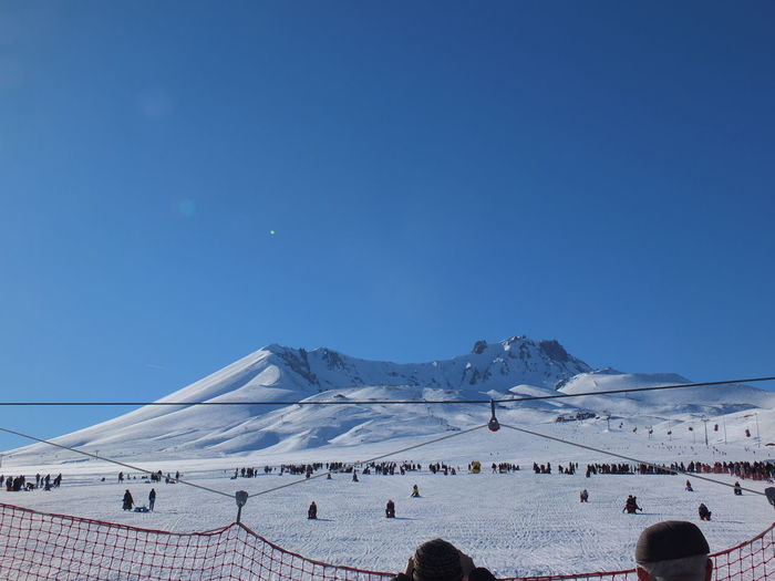 Erciyes 2800 Metre Sky Winter Cold Temperature Snow Nature Mountain Scenics - Nature Beauty In Nature Clear Sky Copy Space Blue Sport Day Large Group Of People Land Tranquil Scene Leisure Activity Group Of People Sunlight Snowcapped Mountain Outdoors My Best Photo
