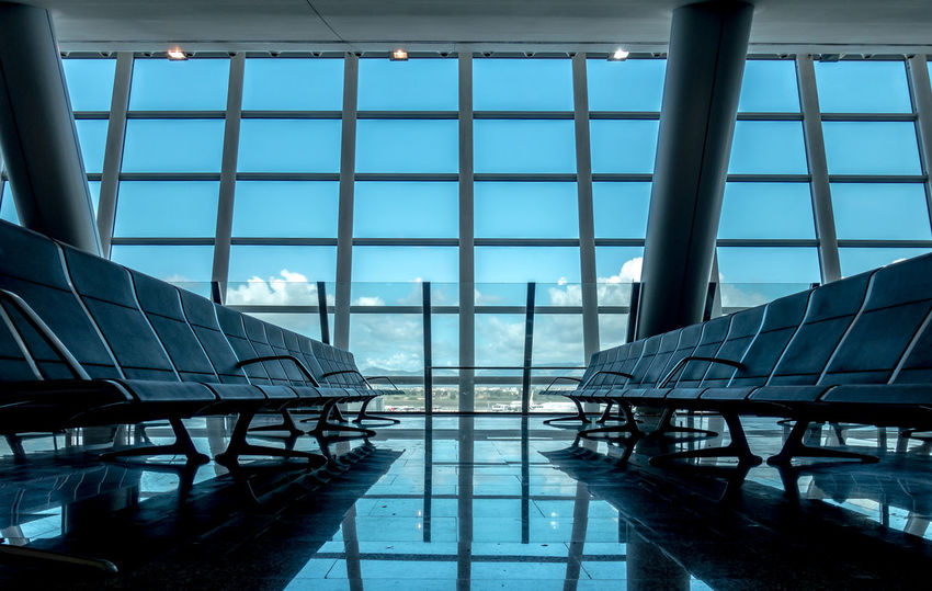 Architecture Bench Departure Lounge EyeEm Gallery EyeEmBestPics In A Row Lines Modern Modern Architecture Reflection The Week On EyeEm Waiting Hall Airport Benches Blue Sky Built Structure Day Indoors  Lines And Shapes Modern No People Pattern Seating Sky Krull&Krull Images Been There. The Graphic City Colour Your Horizn