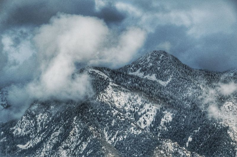 Snow clouds surrounding the mountains. Nature Mountain Tranquility Beauty In Nature Scenics Outdoors Mountain Range No People Sky Cold Temperature Snow Landscape Utah Fine Art Photography Nikon Sandy Utah Nature