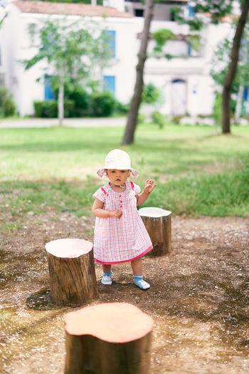 Cute girl wearing hat on wood