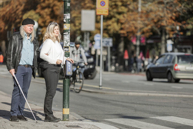 Full length of young woman on road in city