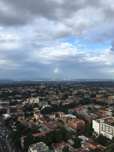 Architecture buildings and rain bow Ponte City Areal Side Yeovillebuildings EyeEm Best Shots EyeEmNewHere Cloudy Shortrainbow Rainbow Jozi Ntsudzu Cityscape Architecture Building Exterior Crowded Cloud - Sky Sky City Day Nature Aerial View Built Structure Outdoors