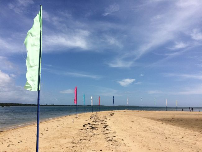 Flags all over the Luli Island! Finding New Frontiers Flags Flags In The Wind  Sea Honda Bay Beach Water Sand Cloud - Sky No People Horizon Over Water Scenics Puerto Princesa City Palawan Philippines Traveling Home For The Holidays Puerto Princesa Eyeem Philippines EyeEm Best Shots Eyeem Photography Island Outdoors Sky Mobilephotography Art Is Everywhere EyeEm Diversity
