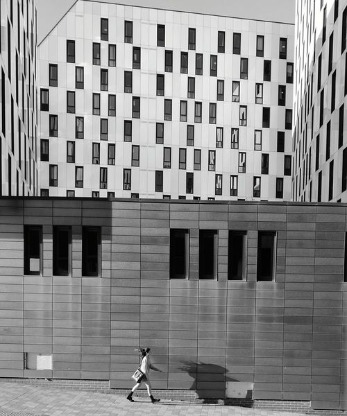 SHADOW looking BACK... Architecture_collection Building Exterior Full SCity Leisure Activity Casual Clothing City Life Day Outdoors Repetition Blackandwhite Black And White Collection  Eyeembestshot_landscape Dramatic Angles Monochrome Photography Architectural Design Architectural Feature Woman Of EyeEm Windswept Windowsaroundtheworld This Week On Eye Em Architecture High Fashion People Shadow-art Highstreetfashion Blackandwhite Photography TakeoverContrast Fashion Photography Lifestyles Modern Art FreshonEyeem