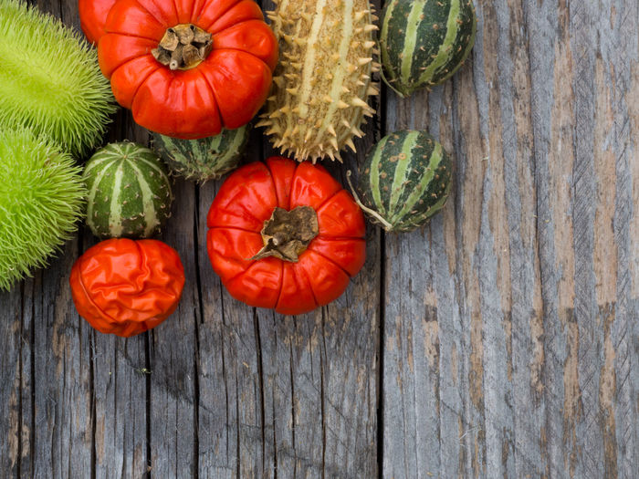 Autumn Cucumber Freshness Green Color Halloween Holiday Natural Red Rustic Thanksgiving Vegetarian Food Chili  Colorful Food Healthy Organic Pepper Prickly Season  Seasonal Striped Table Tomatoes Vegetable Wood - Material