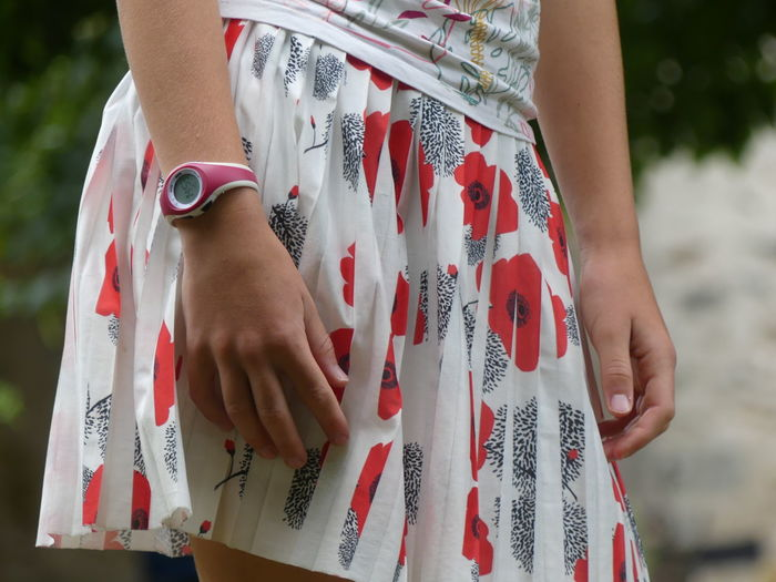 Adult Casual Clothing Close-up Day Focus On Foreground Front View Hand Holding Human Body Part Human Hand Leisure Activity Lifestyles Midsection Nail Nail Polish One Person Real People Red Standing Women