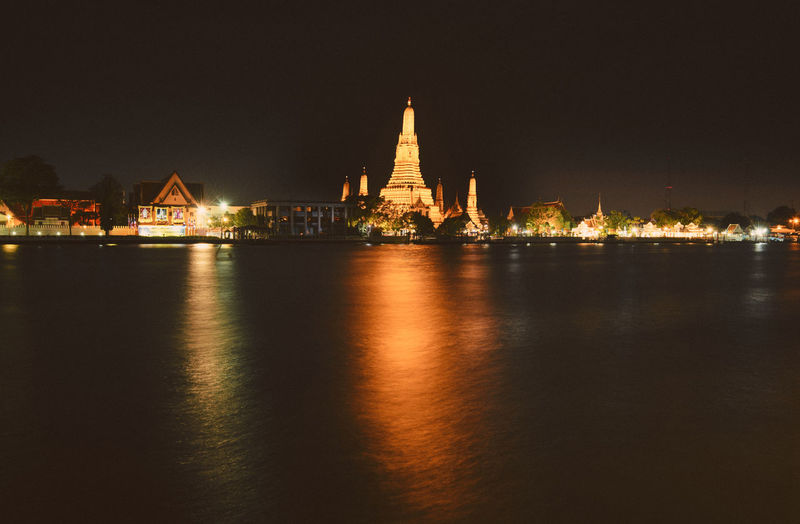 Architecture Building Exterior Water Built Structure Illuminated Waterfront Night Travel Destinations No People Sky Nature Tourism Religion River Travel Building Belief Place Of Worship City Outdoors Wat Arun Temple Dawn Long Exposure