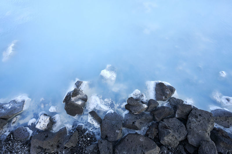 Scenic view of frozen sea and rocks