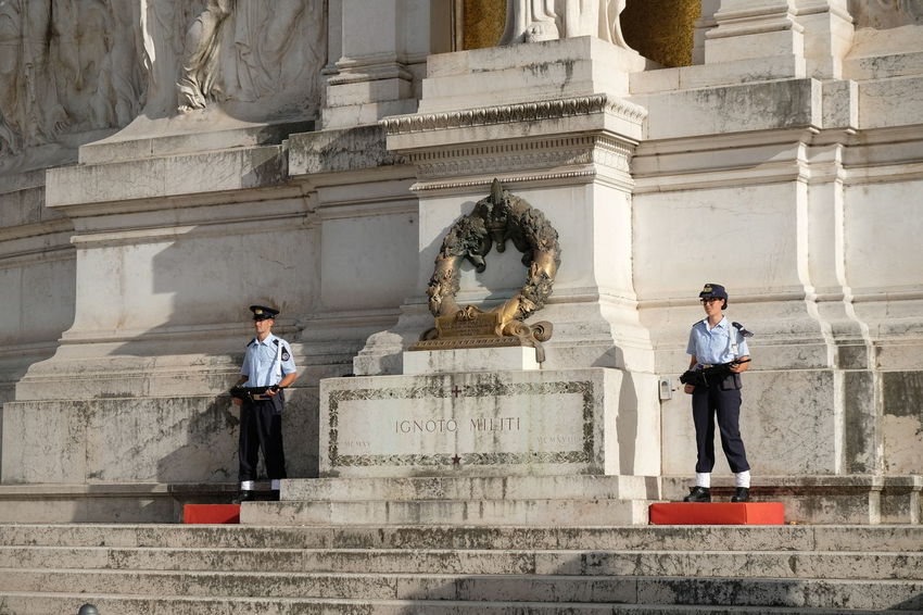 Rome, Italy - August 11, 2017: Guards at the Tomb of the Unknown Soldier at the Vittoriano, Altar of the Fatherland or Victor Emanuele II monument in Piazza Venezia in Rome Altar Of The Fatherland Rome Monument Altare Della Patria Altare Della Patria Building Exterior Altare Della Patria Dal Circo Massimo Guards Memorial Piazza Venezia Piazza Venezia Rome Tomb Of Unknown Soldier Vittoriano Altar Of The Fatherland Altare_della_patria Altaredellapatria Architecture Art And Craft Building Exterior Built Structure History Outdoors Piazza Venezia, Roma Real People Sculpture Standing Statue Tomb Of The Unknown Soldier